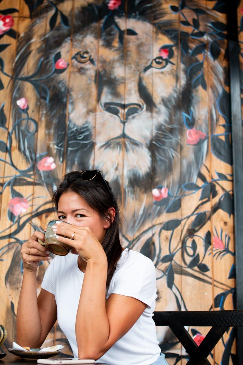 Kim drinking coffee from Imigongo Cafe
