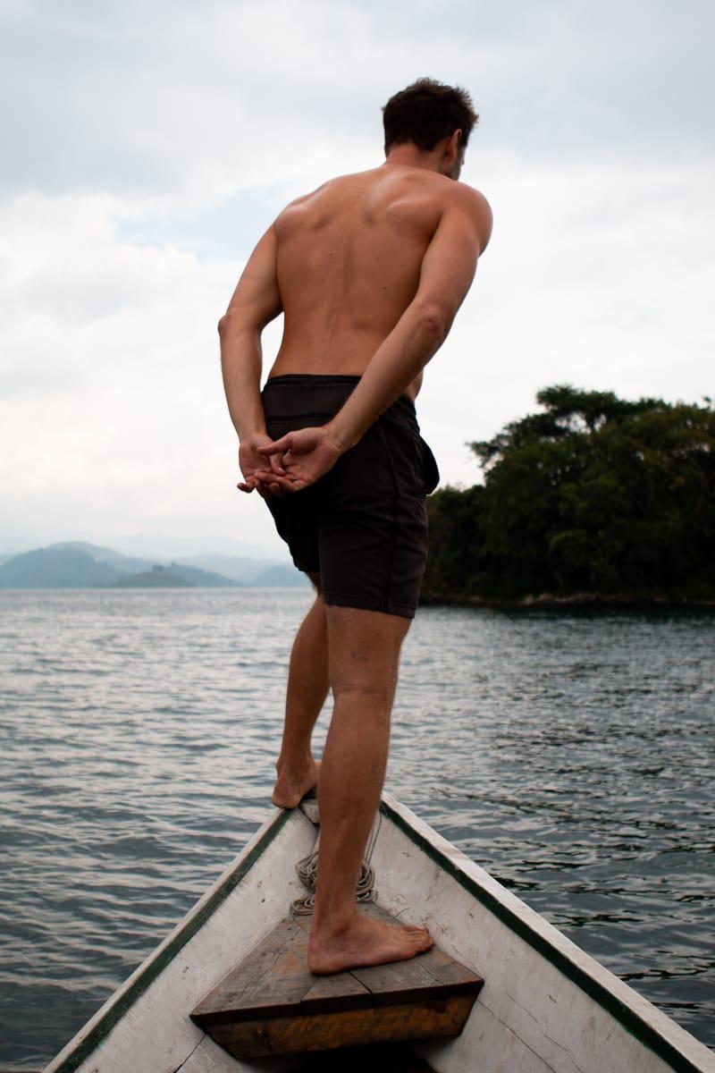 Chris peering over the boat on Lake Kivu