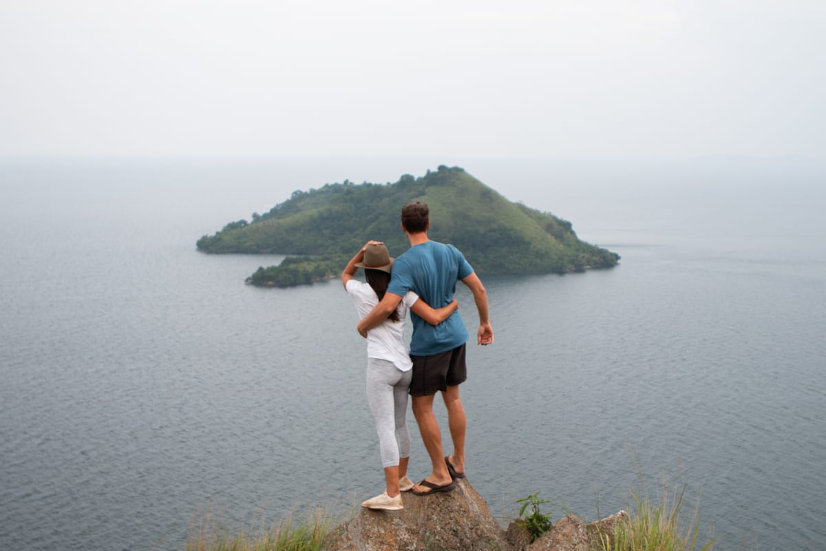 Rwanda itinerary guide cover image of Chris and Kim at Lake Kivu