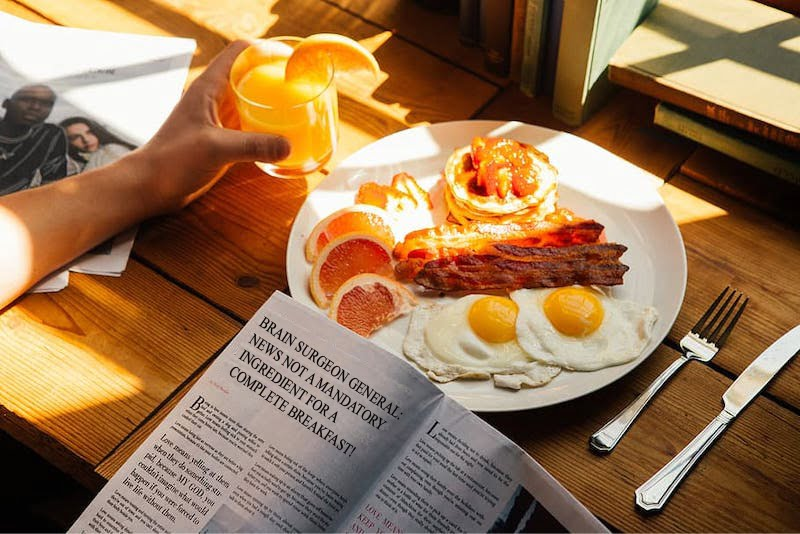Reading the news at breakfast