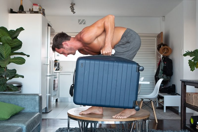 Strength training at home cover image of Chris doing suitcase lift