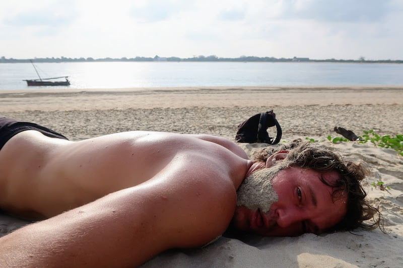 Chris exhausted on the sand.