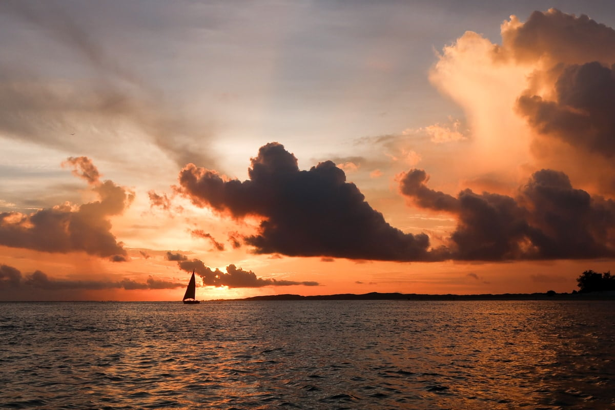 achieve self-actualization tips - sailboat sailing into the distance in kenya.