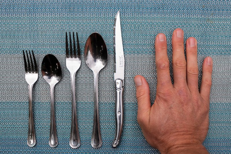 Eat with your hands cover image of hand beside cutlery