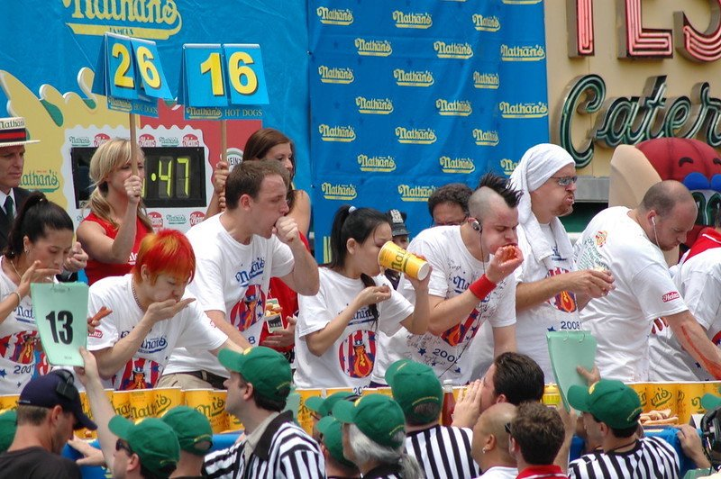 Eating with hands at hotdog eating competition