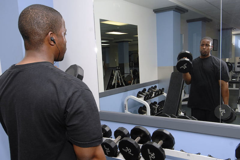 Man suffering from boringness in his fitness routine