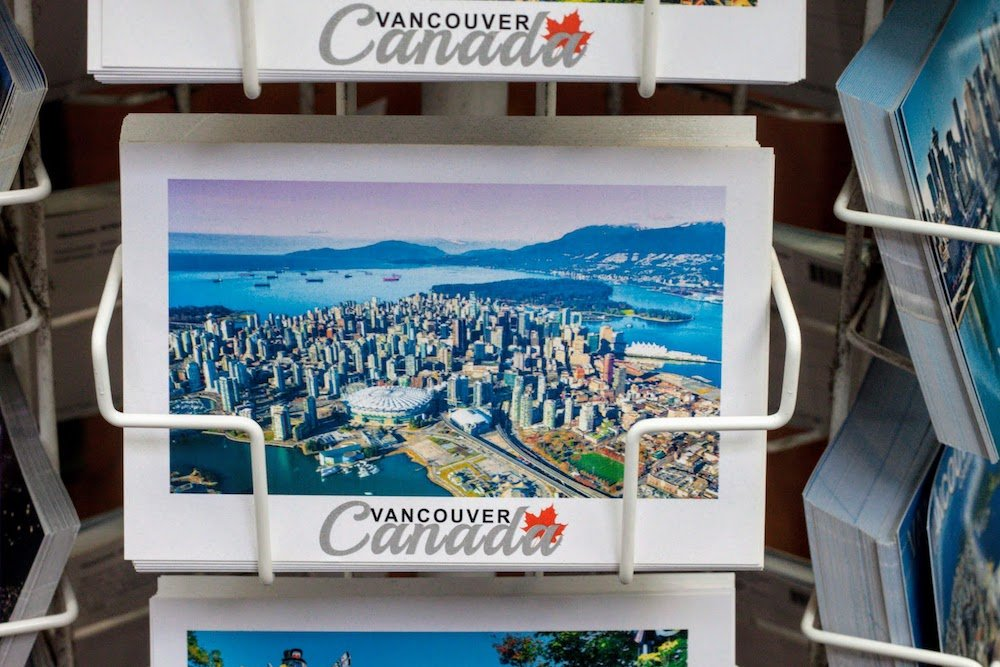 Be a tourist in your own town cover of a postcard from our hometown of Vancouver