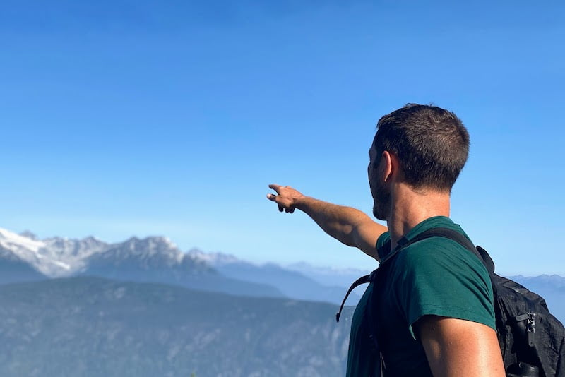 Personal mission statement cover image of person pointing toward distant mountain peak
