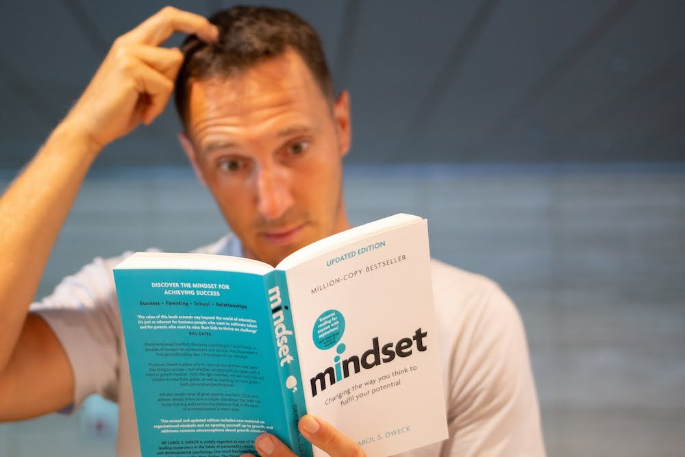 Growth versus fixed mindset cover image of me re-reading Mindset by Carol Dweck